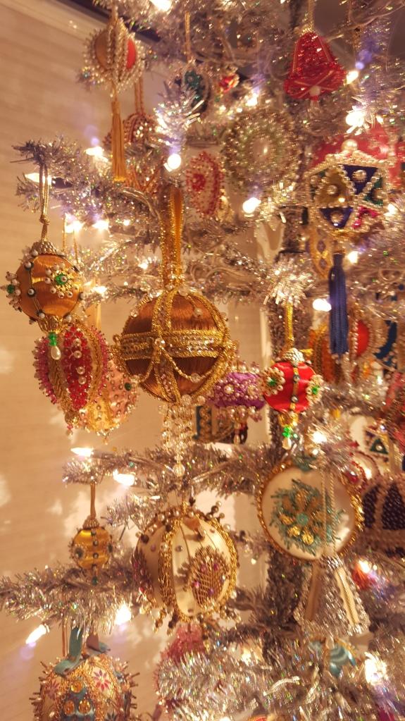 Photo of xmas tree with pin art ornaments.